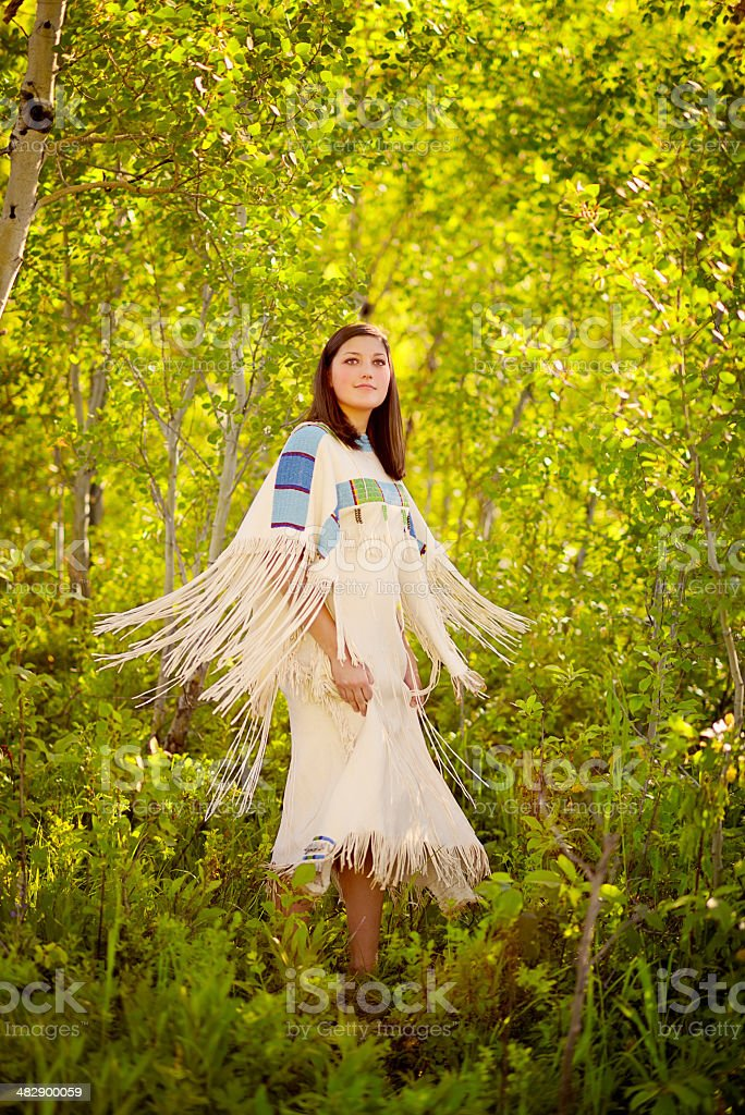 Indian Maiden In Long White Fringed Leather Deer Skin Dress royalty-free stock photo