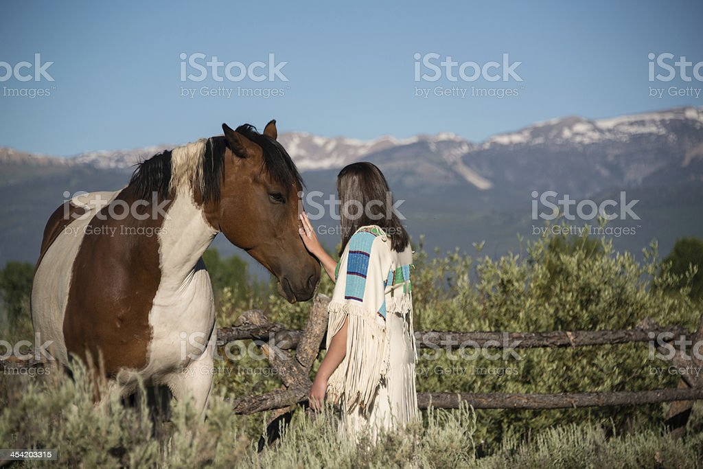 indian maiden with horse among mountains stock photo