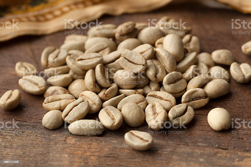 Indian Malabar green unroasted coffee beans stock photo