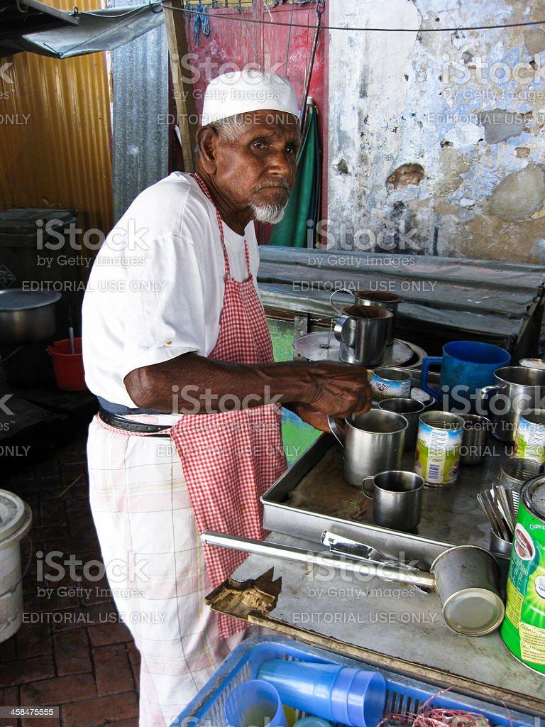 Indian Malaysian man making teh tarik royalty-free stock photo