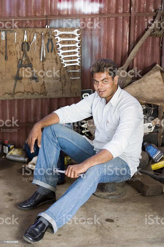 Indian Male Manual Worker Car Mechanic Tools People Vertical Servicing royalty-free stock photo