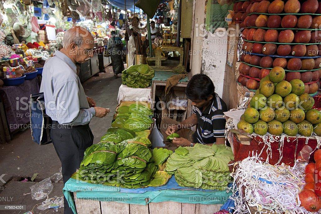 Indian man buying banana leaves in Mysore bazaar stock photo
