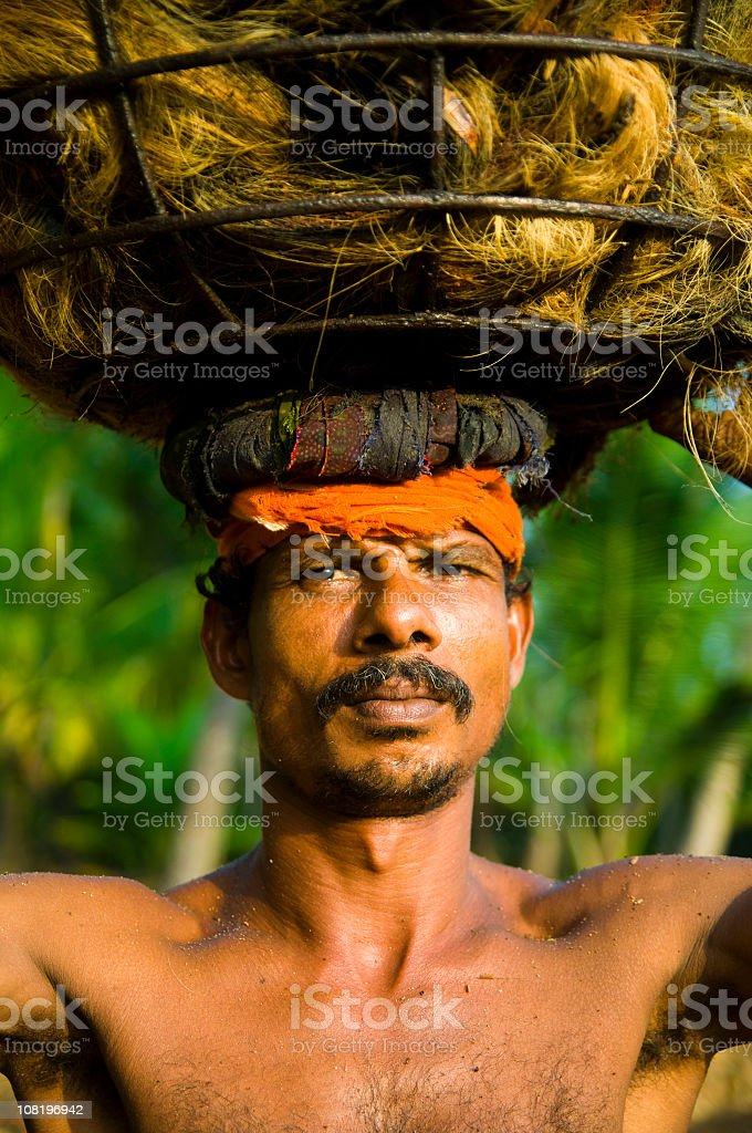 Indian Man Carrying Basket on Head royalty-free stock photo