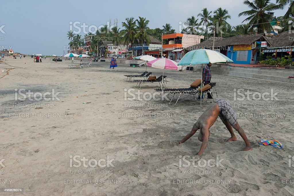 Indian man does exercises of yoga in Kovalam, Kerala, India. stock photo