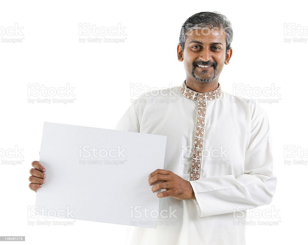 Indian man holding a white board stock photo