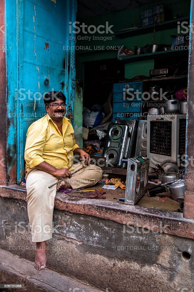 Indian man in front of his store, Bikaner, Rajasthan, India stock photo