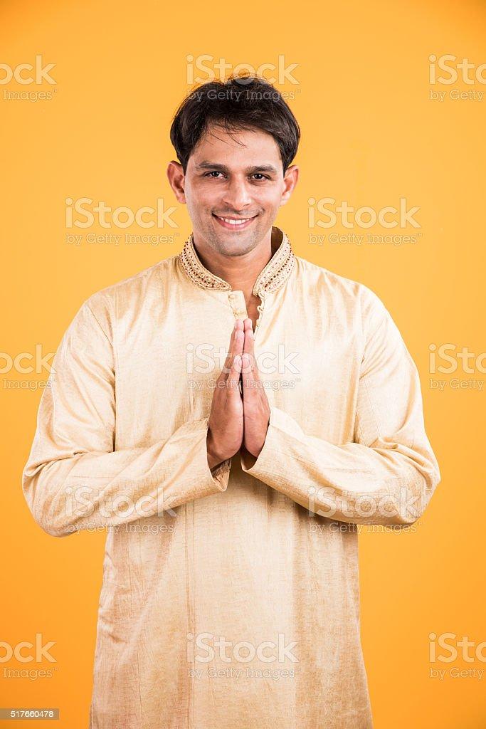 indian man in namaskar or prayer pose stock photo
