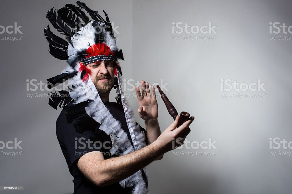 Indian man in the diadem on refuses to smoking stock photo