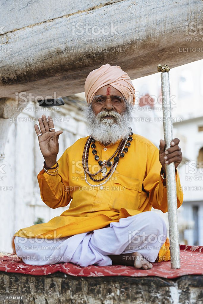 Indian Man Meditating Welcome Gesture,Jagdish Temple,Udaipur,India stock photo