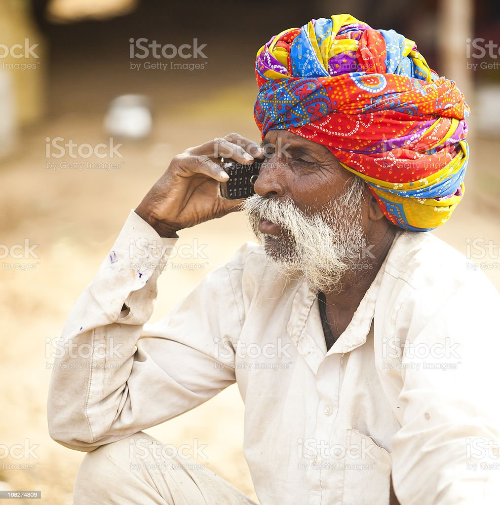 Indian Man on Cell Phone stock photo