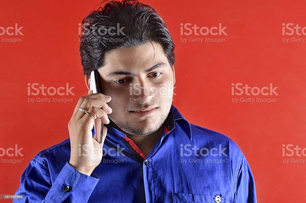 Indian man on mobile stock photo
