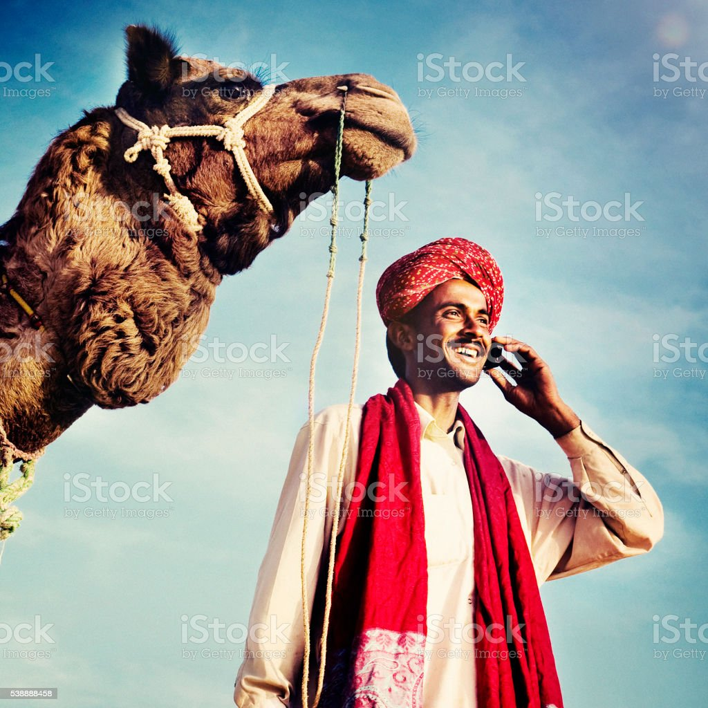 Indian Man On the Phone Camel Communication Concept stock photo