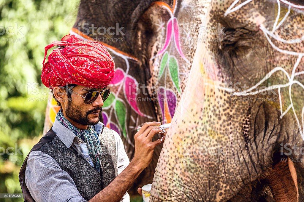 Indian Man Painting Elephant stock photo