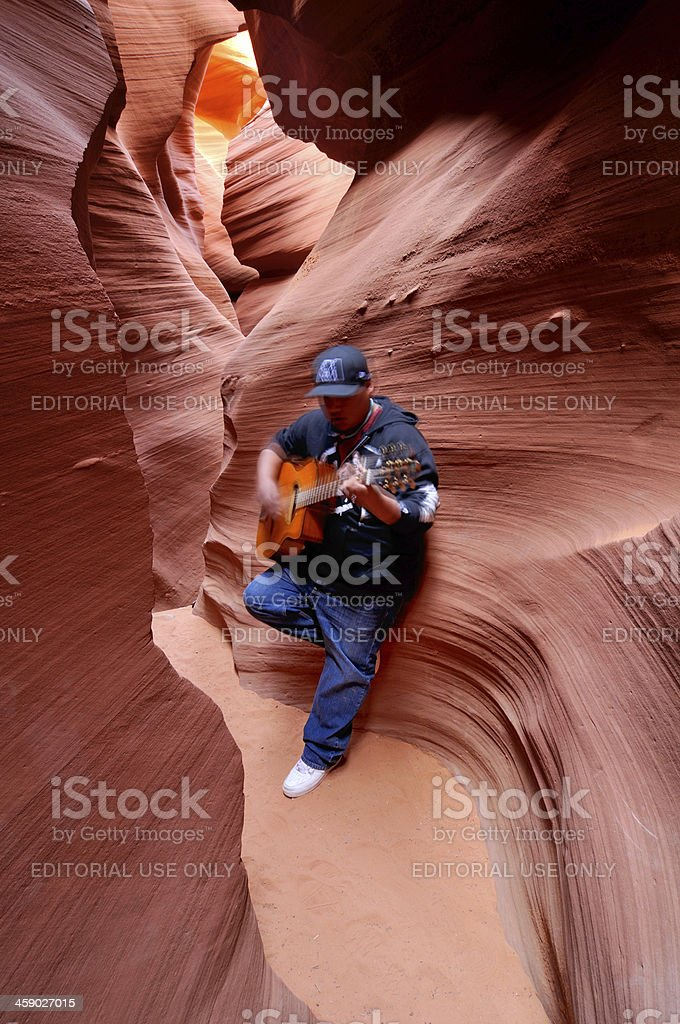 Indian man playing guitar in Lower Antelope Canyon, Arizona, USA royalty-free stock photo