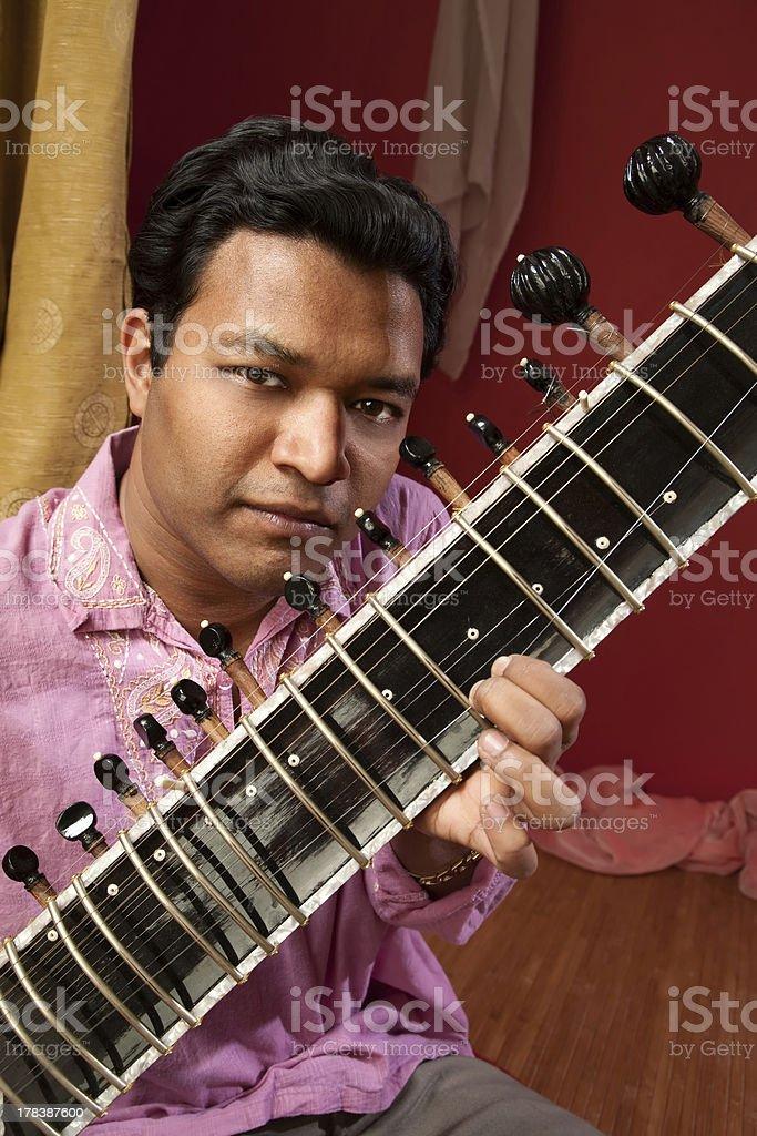 Indian Man Plays a Sitar royalty-free stock photo
