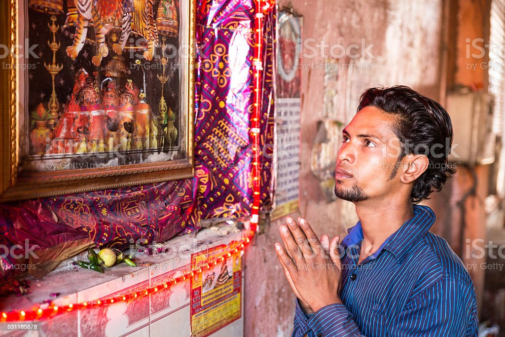 Indian man praying stock photo