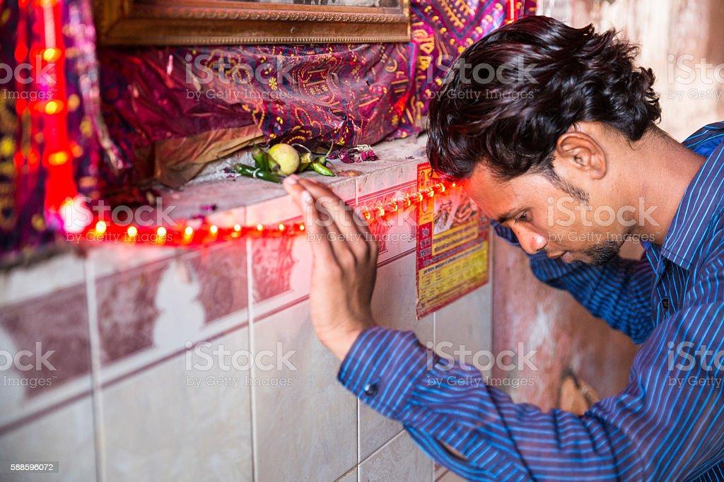 Indian man praying stock photo