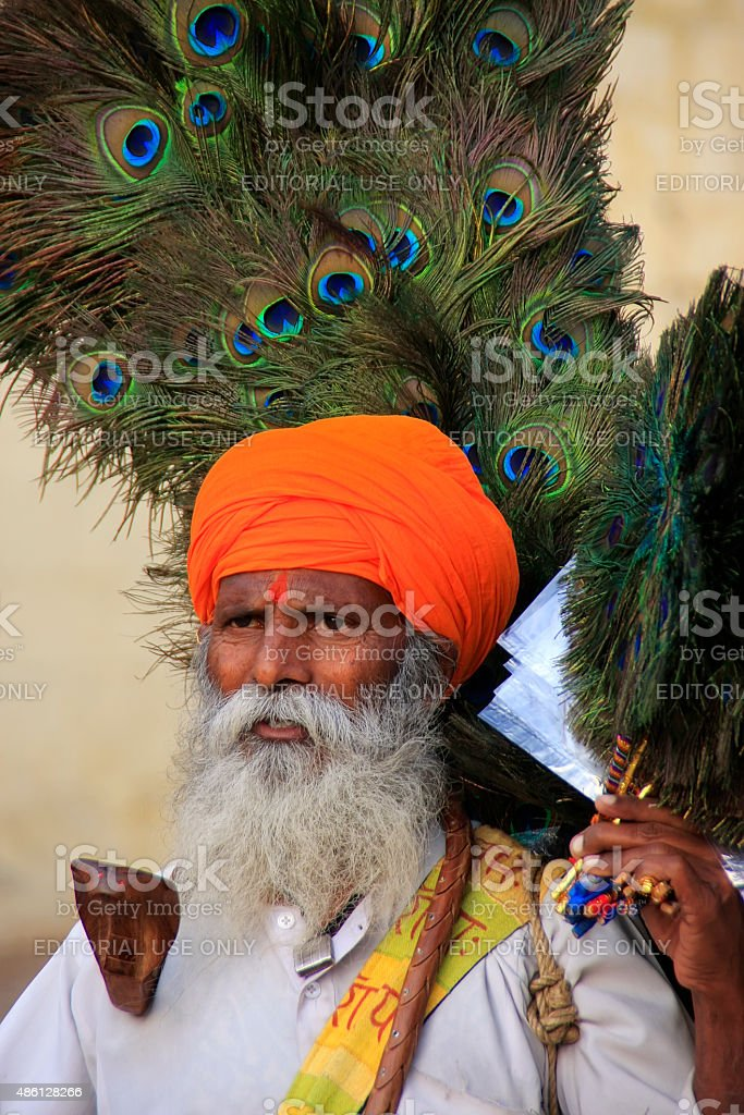 Indian man selling peacock feathers in Jaisalmer fort, India stock photo