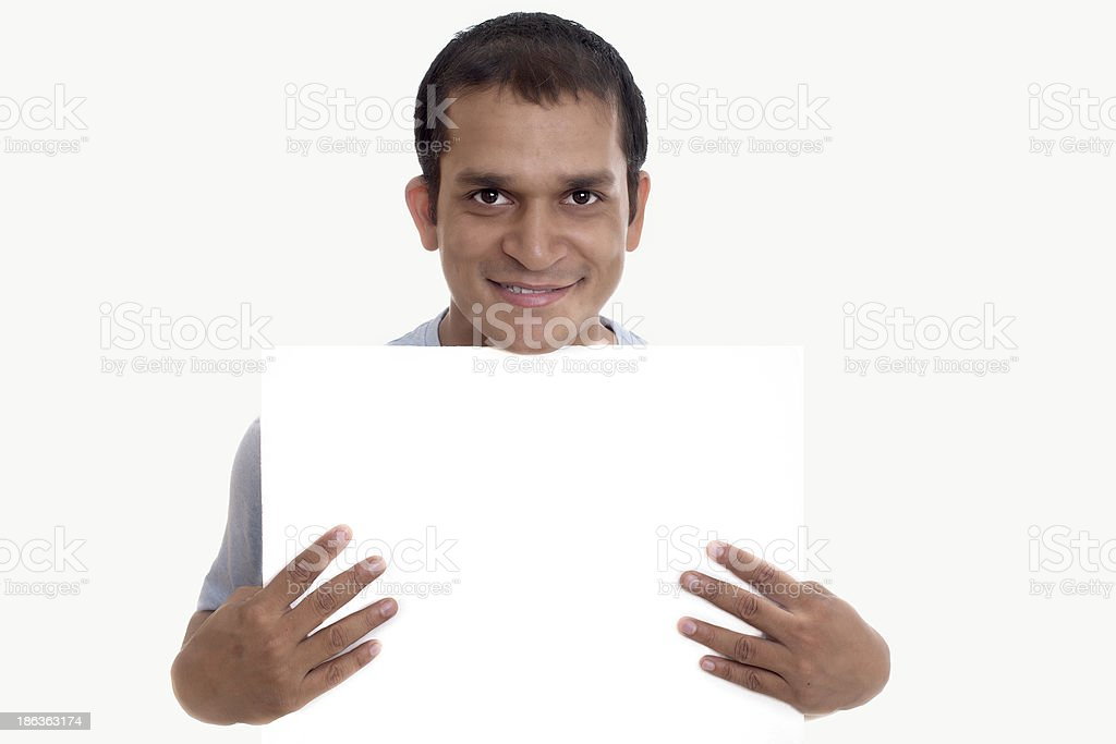 Indian Man showing blank signboard, isolated royalty-free stock photo