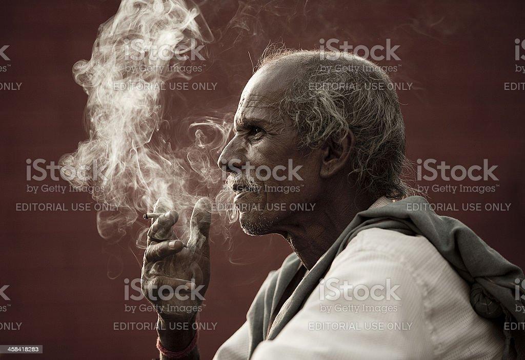 Indian man smoking royalty-free stock photo