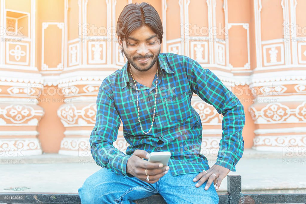 Indian Man Social Networking with Smart Phone in Jaipur stock photo