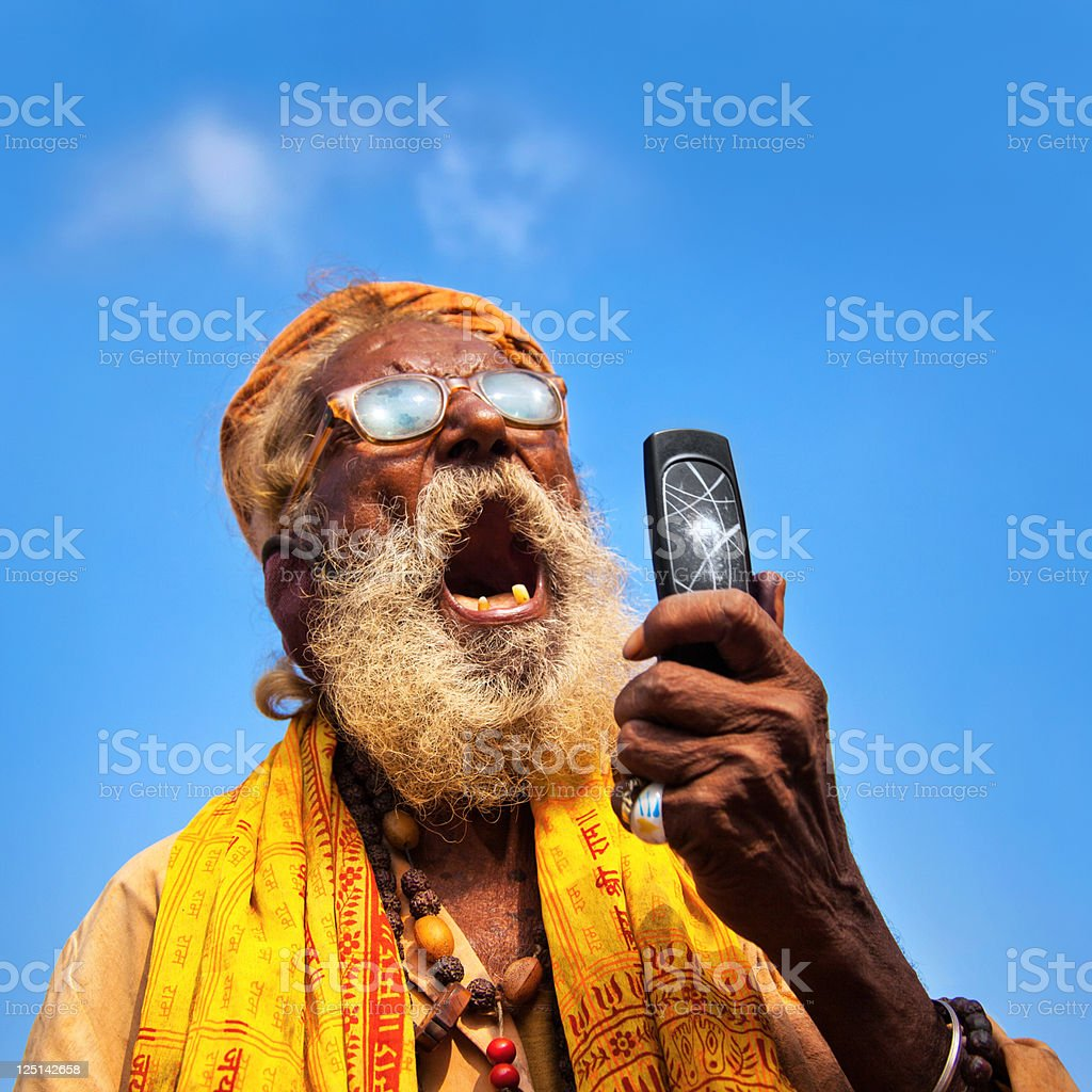Indian man using a mobile stock photo