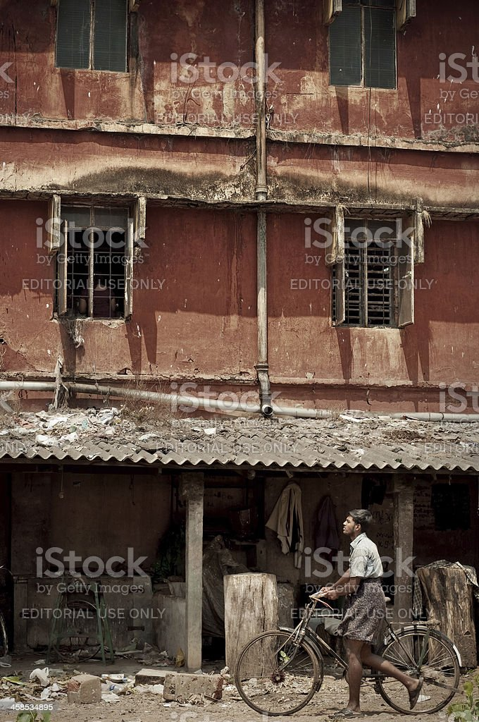 Indian man walking in the slum royalty-free stock photo