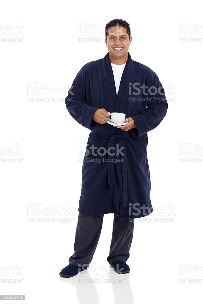 indian man wearing pajamas drinking coffee in the morning royalty-free stock photo