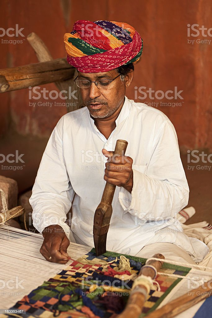 Indian man weaving textiles (durry). Salawas village. Rajasthan. royalty-free stock photo