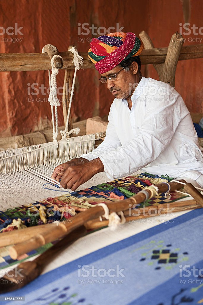 Indian man weaving textiles (durry). Salawas village. Rajasthan. royalty-free stock photo