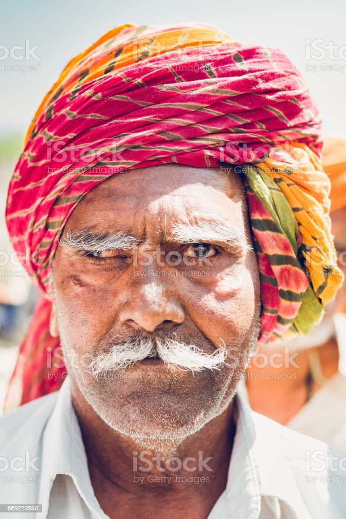 Indian Man with Colorful Turban Squinting Real People Portrait India stock photo
