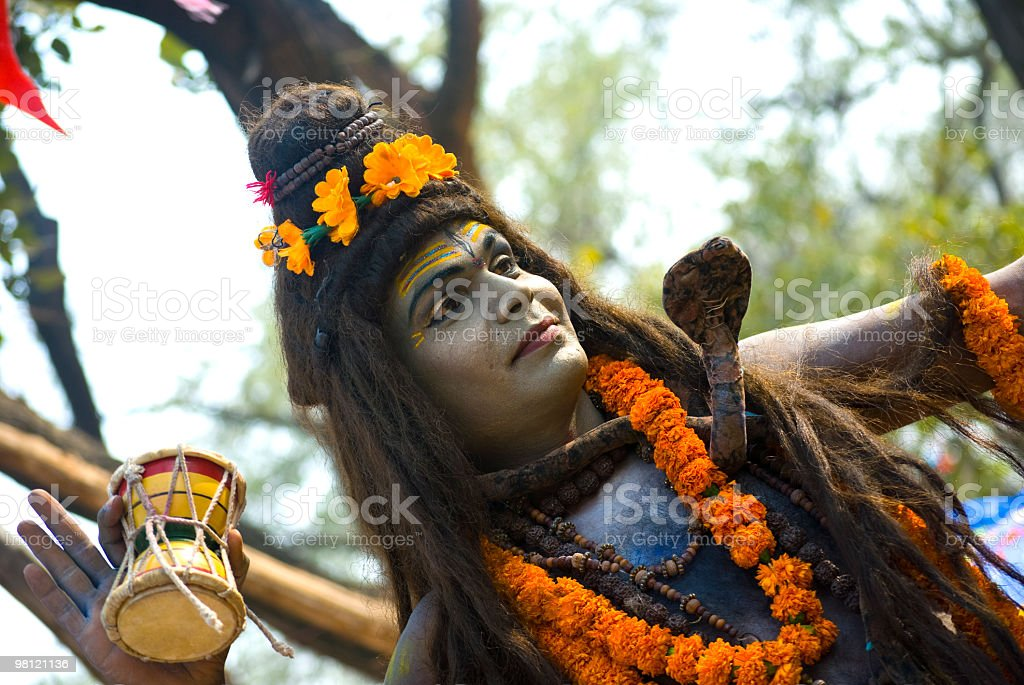 indian man with lord shiva coustume, performing in play royalty-free stock photo