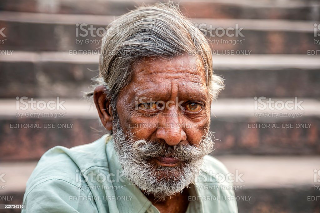 Indian man with moustache sitting on stairs, Delhi, India stock photo