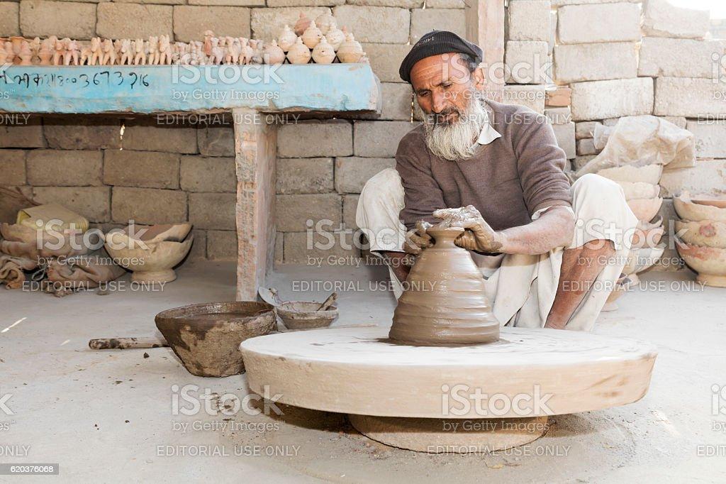 Indian man working at potter's wheel, Rajasthan, India stock photo
