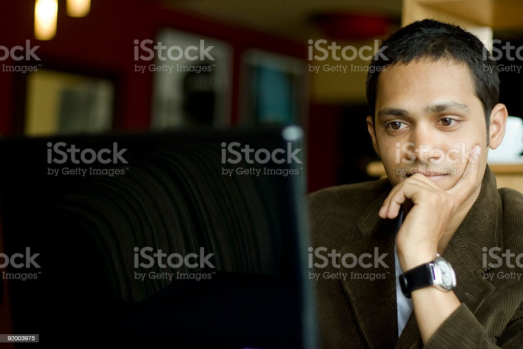 Indian man working on a computer royalty-free stock photo