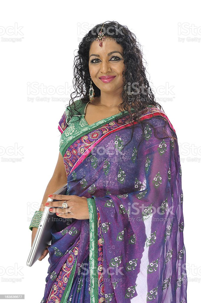 Indian manager wearing traditional sari  and laptop royalty-free stock photo