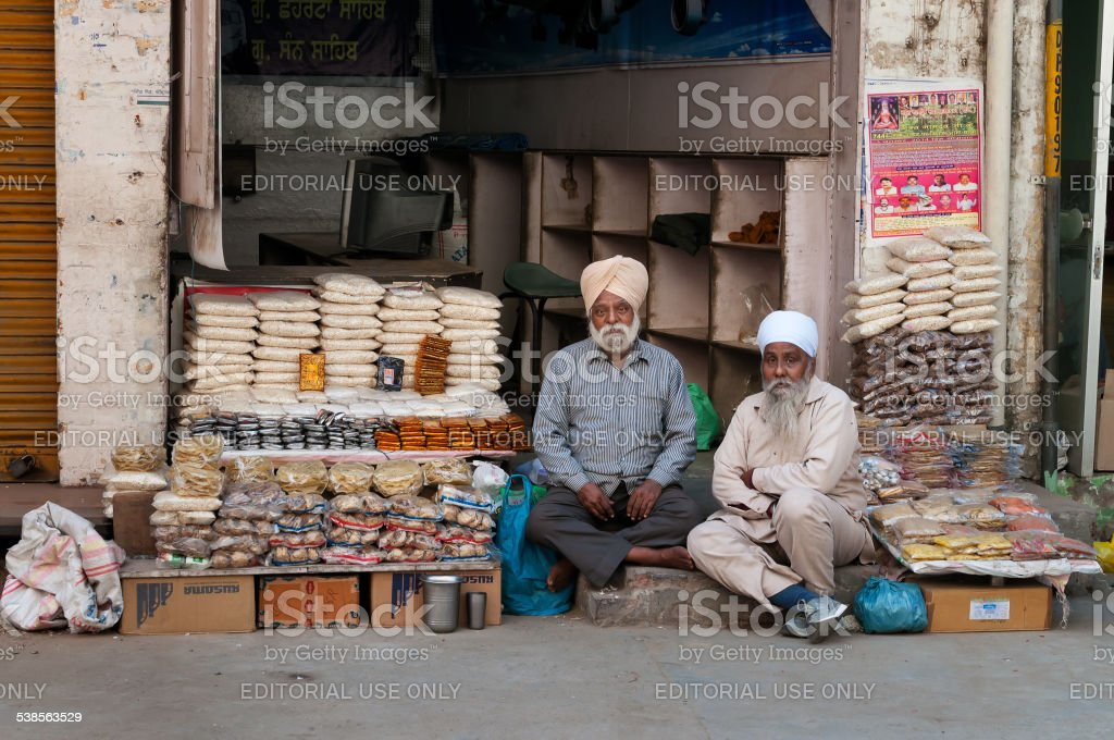 Indian market vendors selling snack in  local street shop stock photo