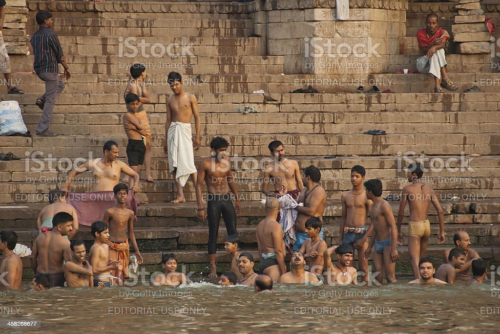 Indian men bathe in Ganga river, Varanasi, India. royalty-free stock photo