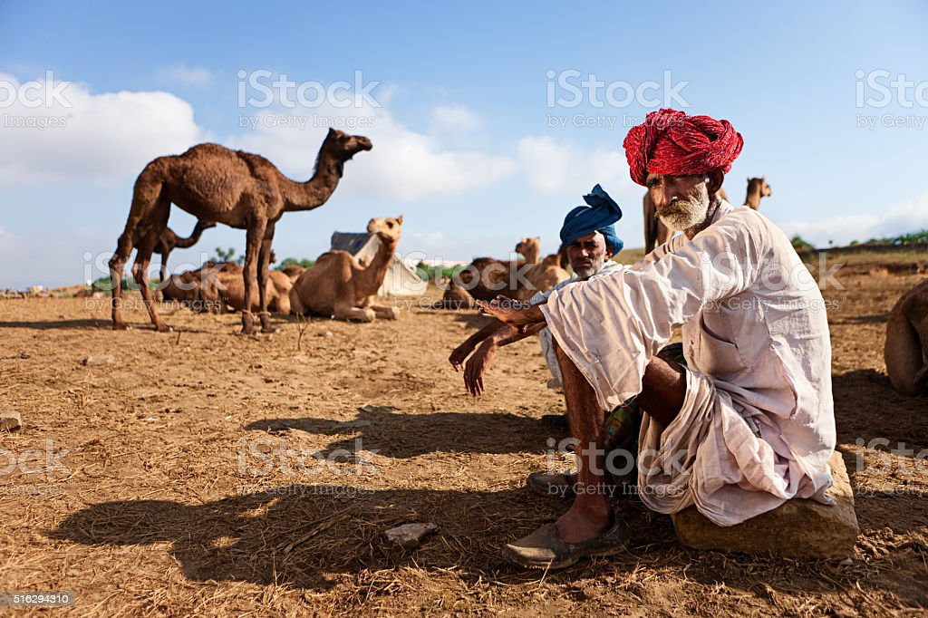 Indian men during Pushkar Camel Fair, India stock photo