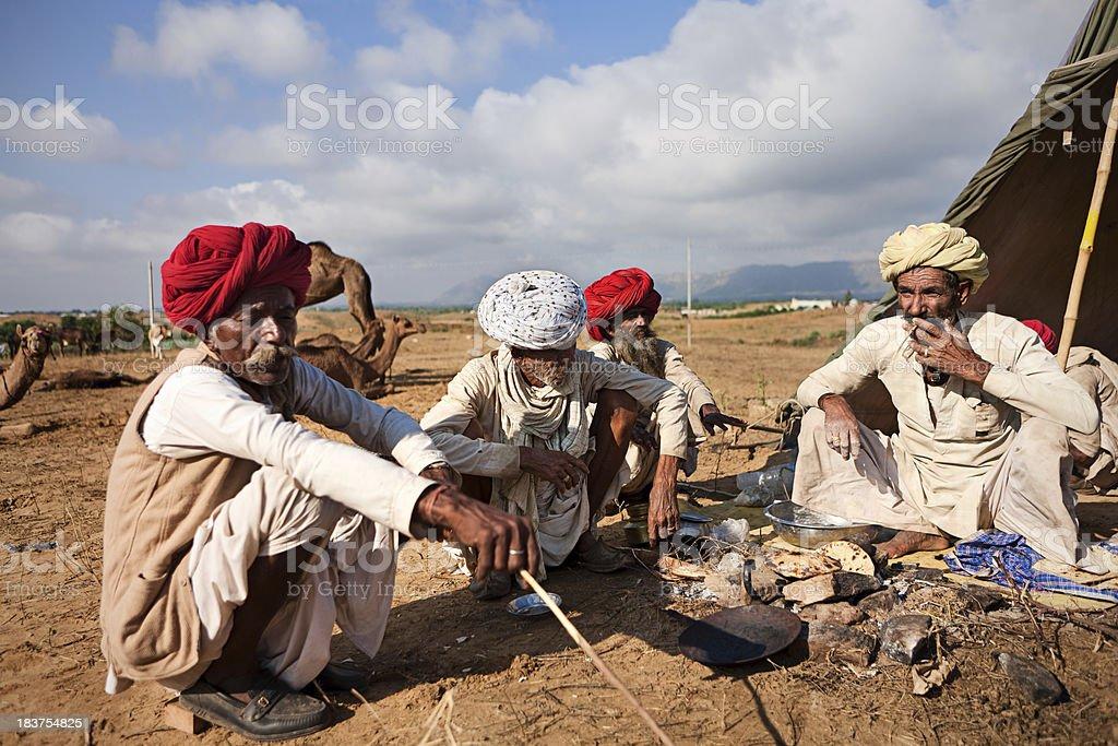 Indian men preparing chapatti bread during festival in Pushkar royalty-free stock photo