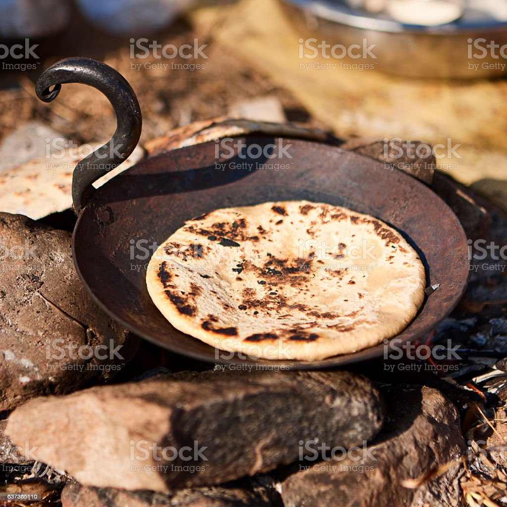 Indian men preparing chapatti bread during festival in Pushkar stock photo