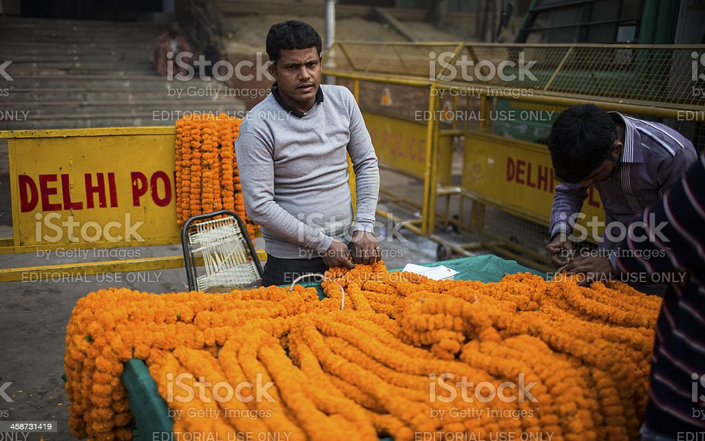 Indian men sell flowers royalty-free stock photo