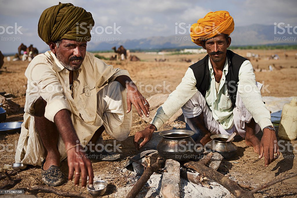Indian men setting up the fire during camel festival.Pushkar royalty-free stock photo