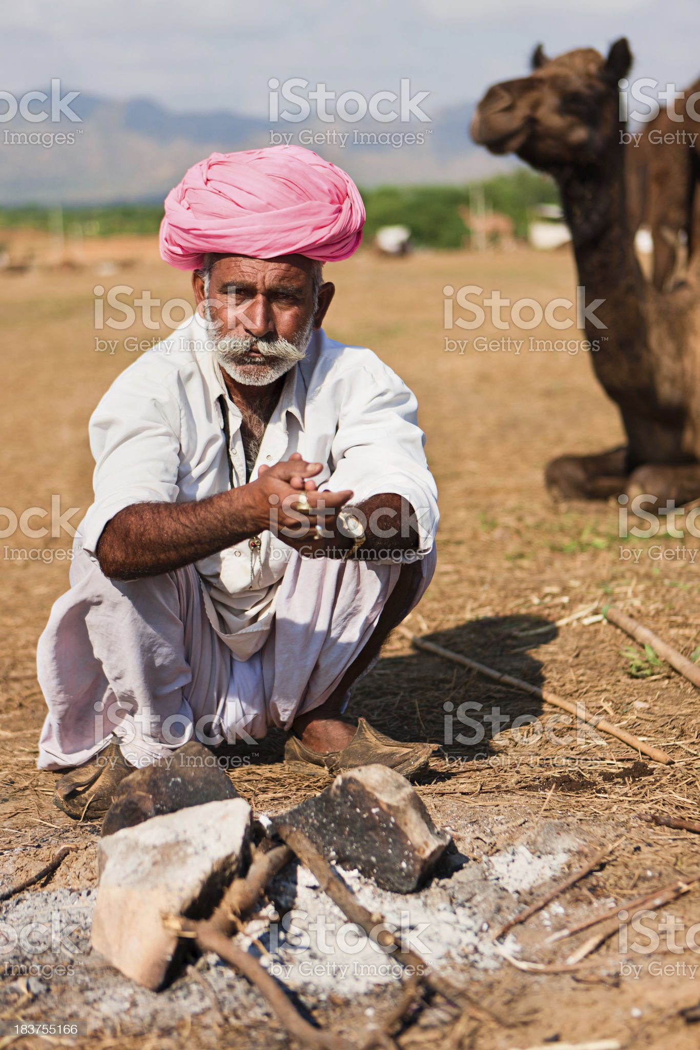 Indian men setting up the fire during festival in Pushkar royalty-free stock photo