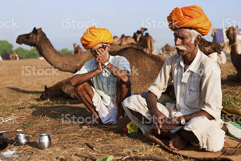 Indian men smoking the pipe during festival in Pushkar royalty-free stock photo