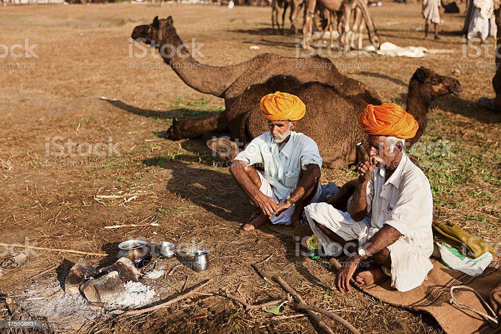 Indian men smoking the pipe during festival in Pushkar stock photo