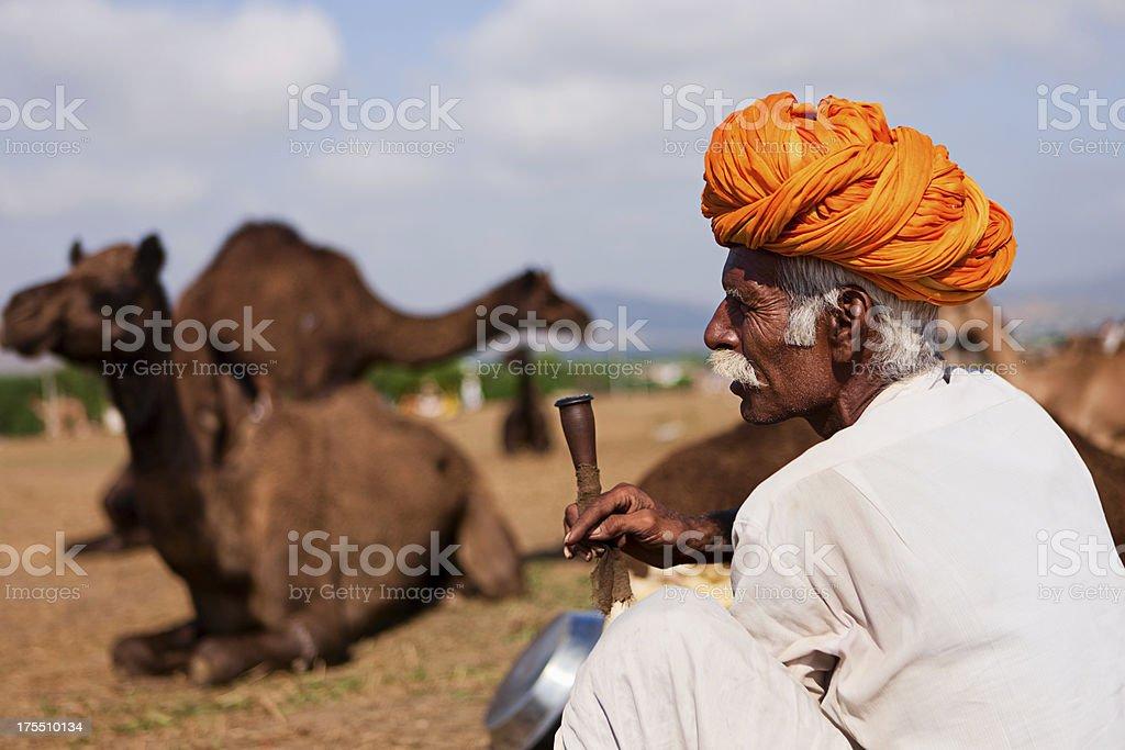Indian men smoking the pipe during festival in Pushkar royalty-free stock photo