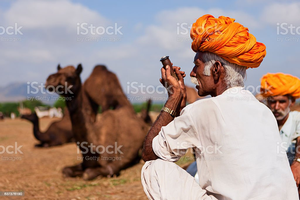 Indian men smoking the pipe during festival in Pushkar stock photo