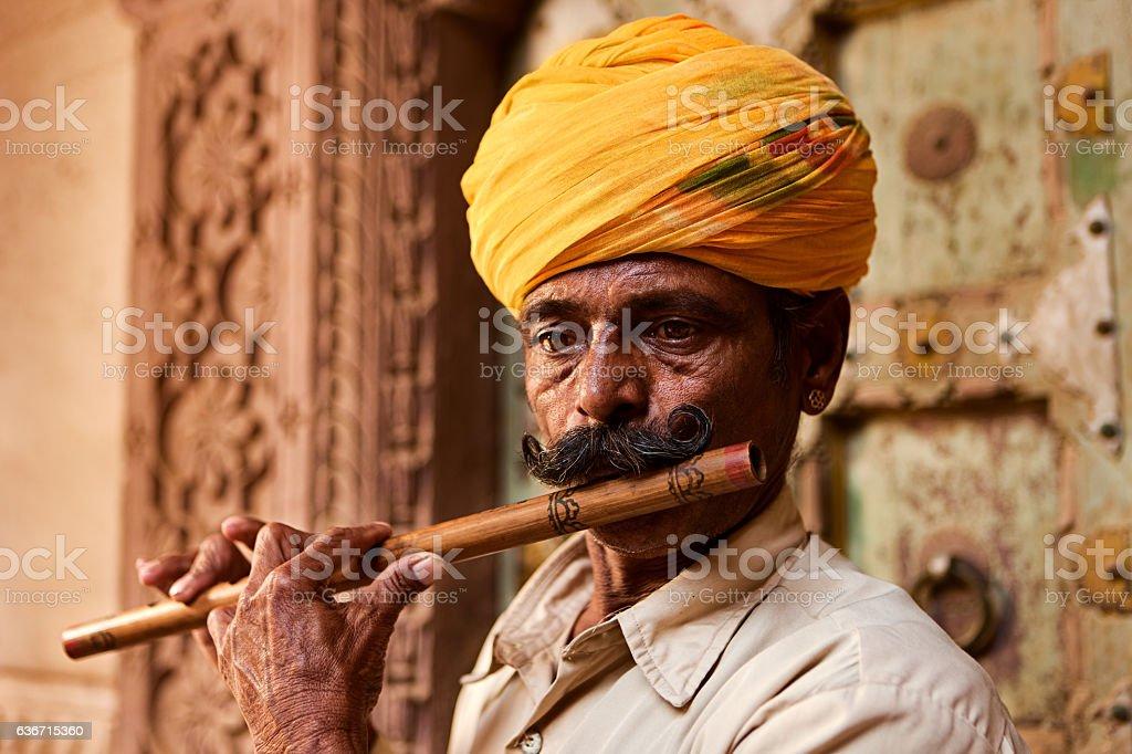 Indian musician playing flute, Jodhpur, Rajasthan stock photo