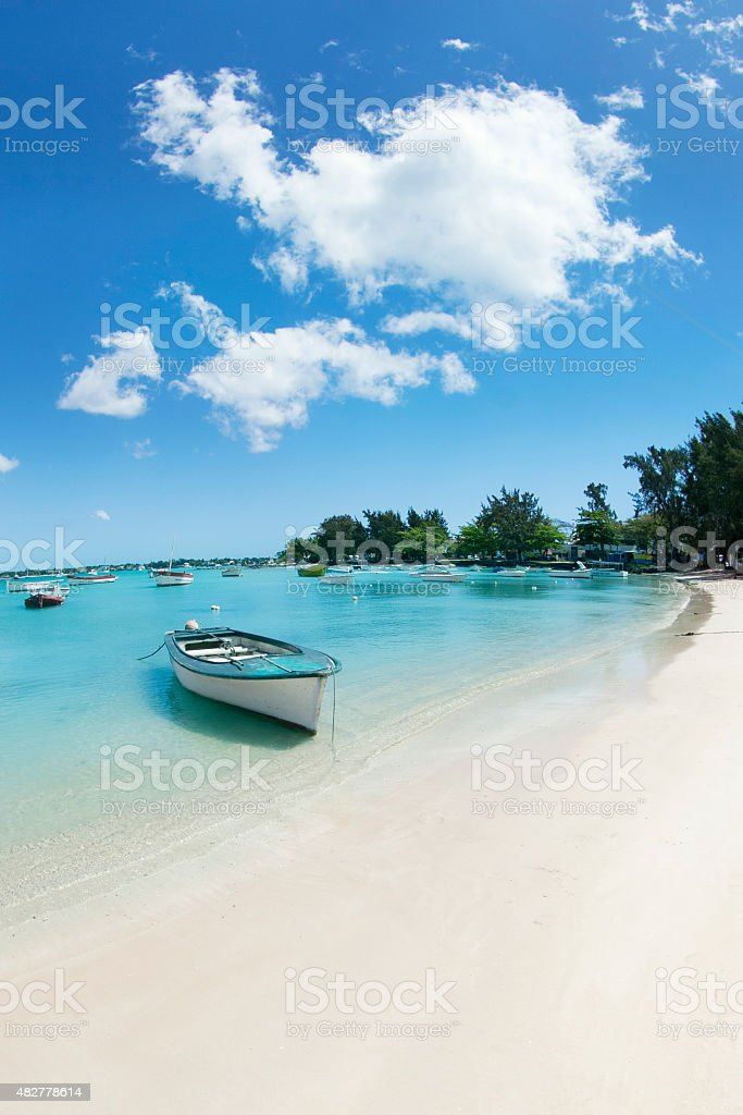 Indian ocean, fishing boat and beach stock photo